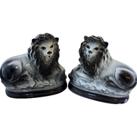 WCI-7700z: Late 19th Century English Staffordshire Grey Lions - a Pair